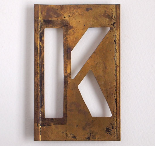 Early-1900s vintage brass plate letter stencil: 'K', 11cm