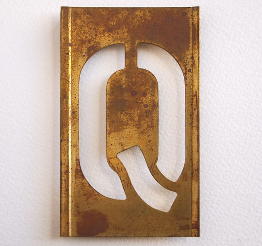 Early-1900s vintage brass plate letter stencil: 'Q'