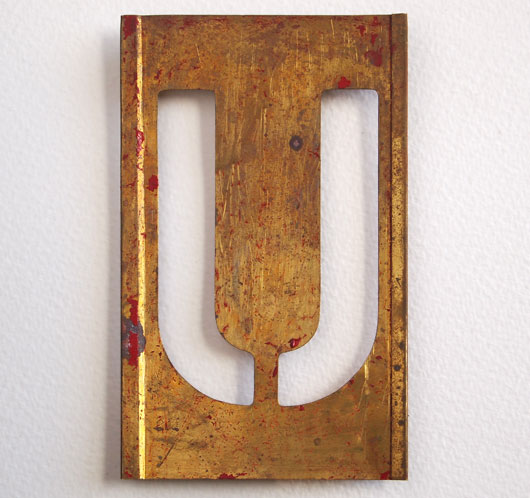 Early-1900s vintage brass plate letter stencil: 'U', 11cm