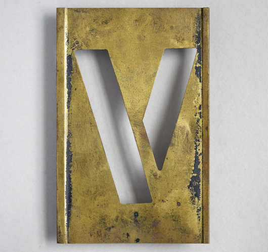 Early-1900s vintage brass plate letter stencil: 'V', 11cm