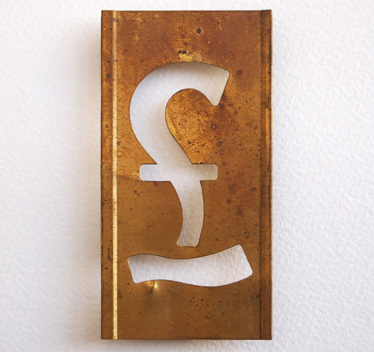 Early-1900s vintage brass plate letter stencil: '£' sign, 11cm