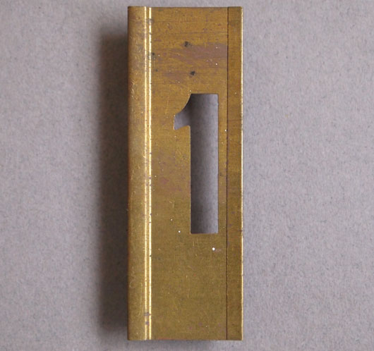Early-1900s vintage brass number stencil: '1'