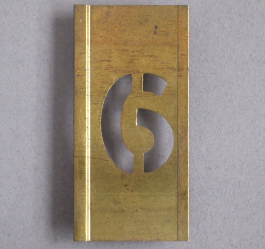 Early-1900s vintage brass number stencil: '6', 6cm