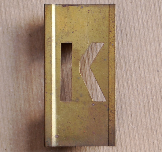 Vintage French brass-plate letter stencil 'K', 6cm