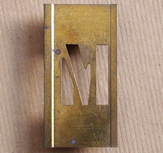 Vintage French brass-plate letter stencil: 'M', 6cm