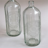 Faceted soda syphon bottles with etched design, mid-1900s