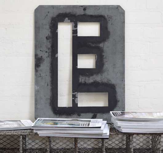 Large antique signwriter's zinc letter stencil 'E'