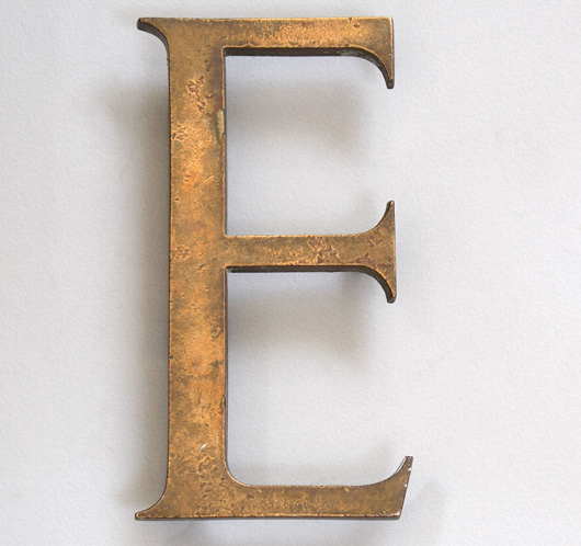 Early-1900s antique cast-brass company sign letter 'E'