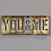 Antique mounted brass sign stencil: You & Me