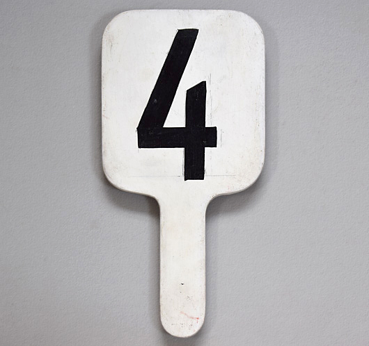 Painted vintage wooden number paddle: '4'