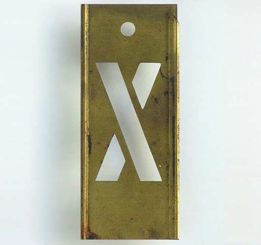 Early-1900s vintage interlocking brass letter stencil: 'X'