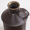 Early-1900s metal fuel jug with screw-in cap
