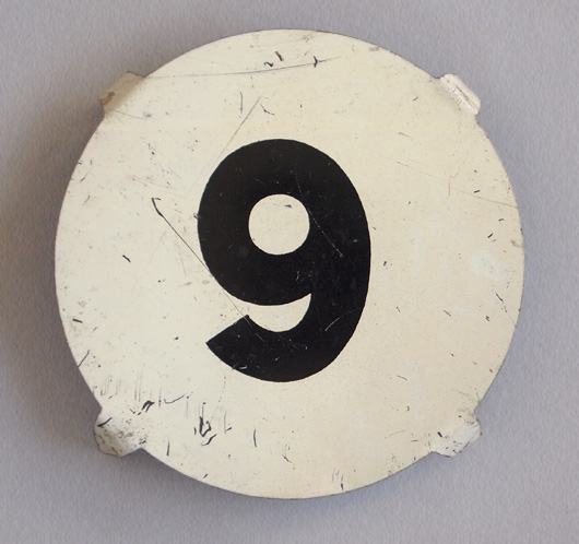 Early-1900s round vintage tin number marker: '9'