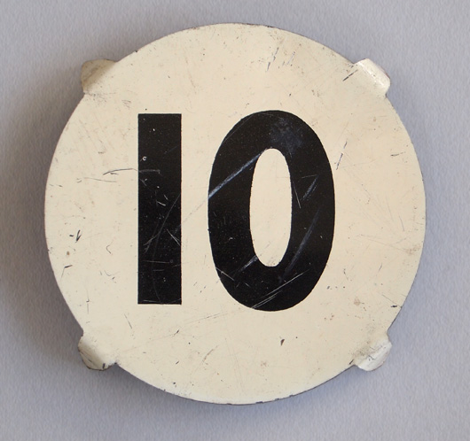 Early-1900s round vintage tin number marker: '10'