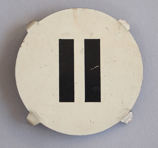 Early-1900s round vintage tin number marker: '11'