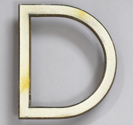 Vintage 1920s white enamel and brass Art Deco style letter 'D'