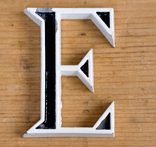 Vintage mid-1900s small black and white metal sign letter 'E'