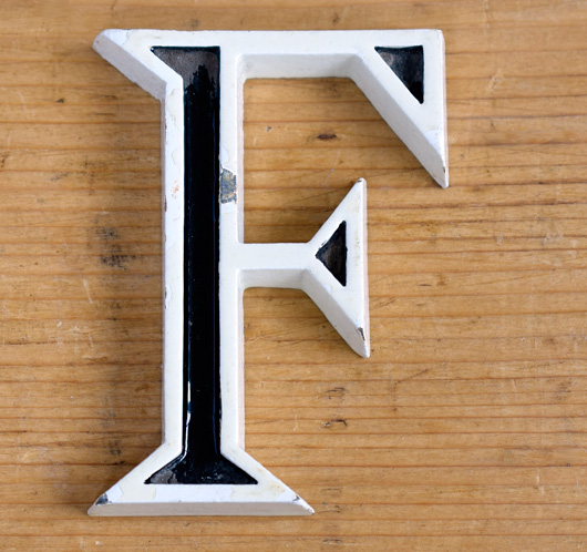 Vintage mid-1900s small black and white metal sign letter 'F'