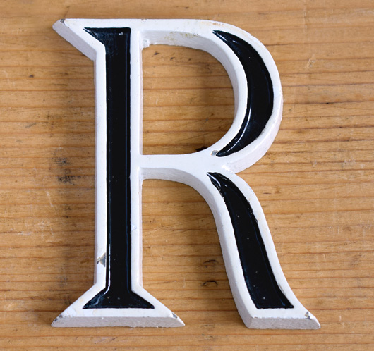 Vintage mid-1900s small black and white metal sign letter 'R'
