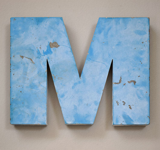 Large vintage blue metal sign letter 'M' or 'W'