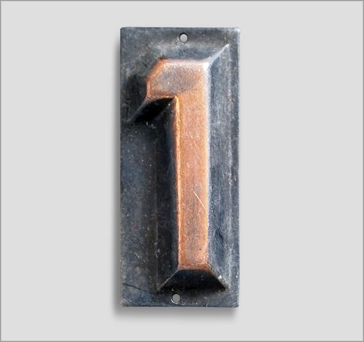 Small embossed brass door sign number '1', c. 1900