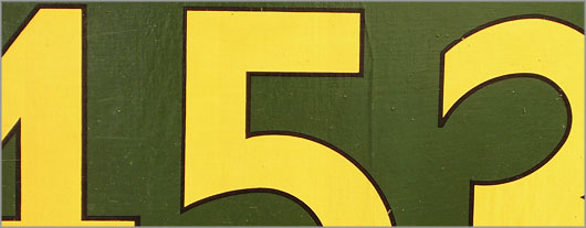 Hand-painted vintage wooden bus route number sign: 453