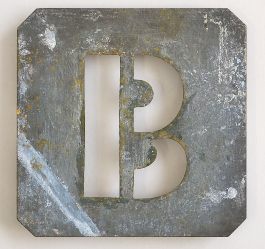 Early-1900s vintage zinc plate letter stencil 'B'
