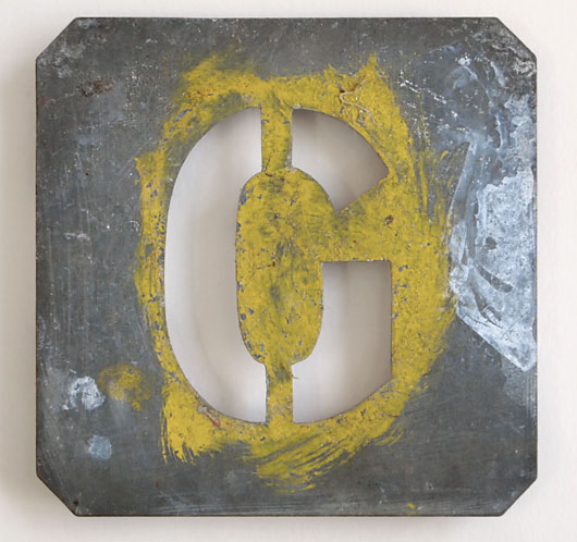 Early-1900s vintage zinc plate letter stencil 'G'