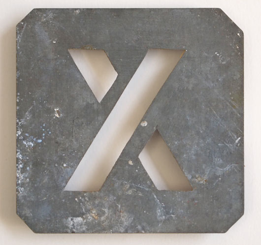 Early-1900s vintage zinc plate letter stencil 'X'
