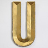 French folded gold-gilt zinc letter 'U', early 1900s