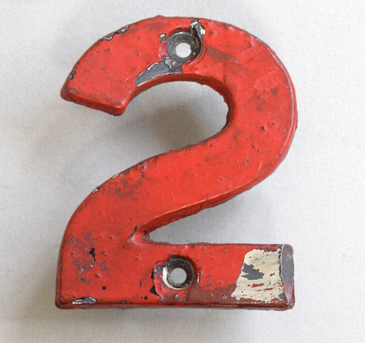 vintage cast-iron railway sign number '2' painted red