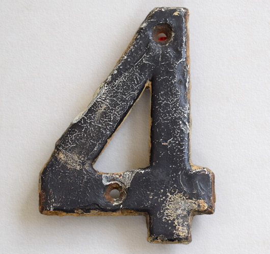 Cast-brass railway sign number '4' painted black