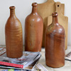 Trio of large 19th-C French stoneware cider bottles