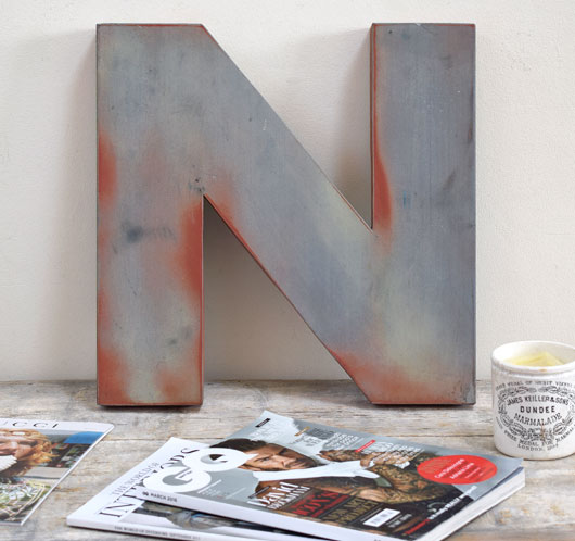 Large weathered metal shop sign letter 'N' or 'Z'
