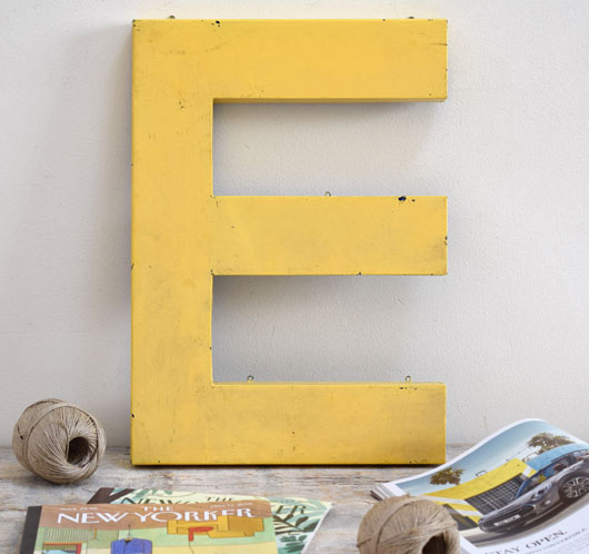 Vintage large ellow painted metal sign letter 'E'