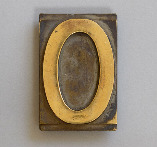 Antique printer's brass letterpress letter 'O', c. 1900