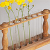 Early-1900s wooden test tube rack vase