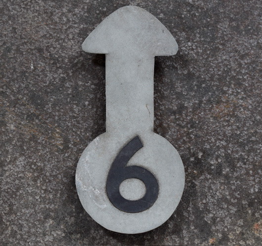 Numbered zinc metal arrow pointer: '6'