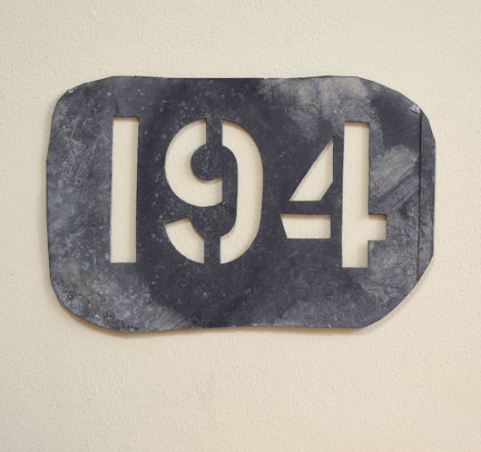 Antique French zinc number stencil: '194'