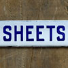 1920s enamel shelf sign: Sheets