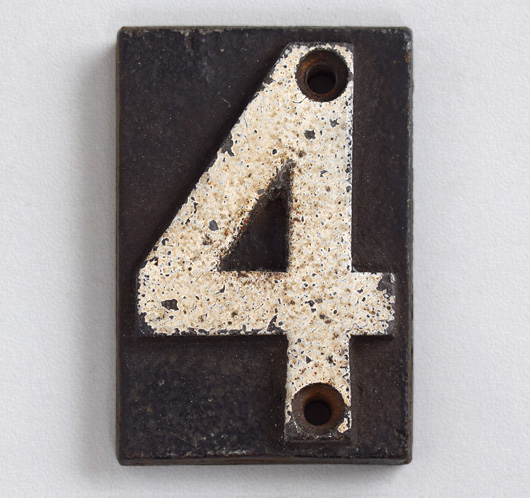 Victorian cast-iron railway sleeper marker number '4'