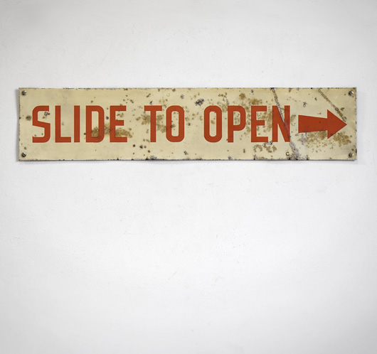 Vintage painted tin sign: Slide To Open