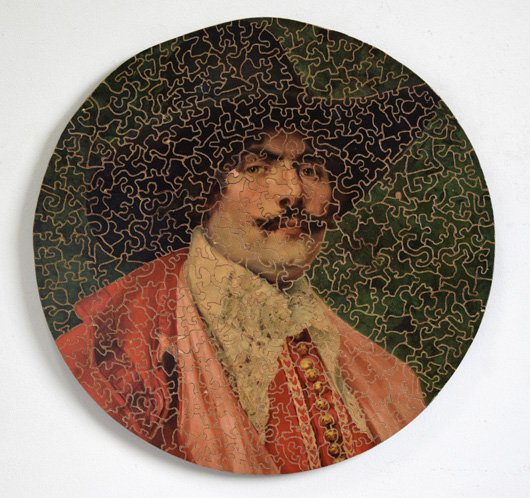 Mounted antique wooden jigsaw puzzle portrait: The Red Cavalier
