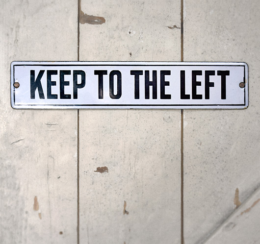 Vintage early-1900s enamel sign: Keep To The Left