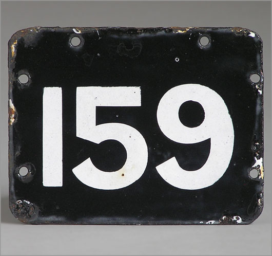 Black and white enamel door number plaque sign '159'