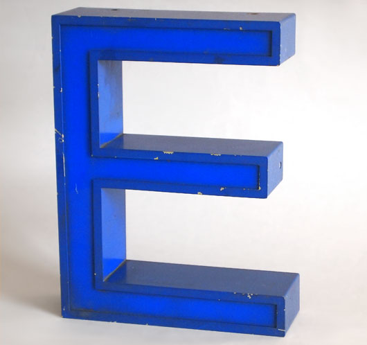 Blue metal and perspex sign letter 'E', c. 1980s
