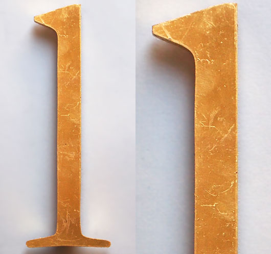 Vintage gold-gilded perspex store sign letter 'l' or 'one', 27.5cm