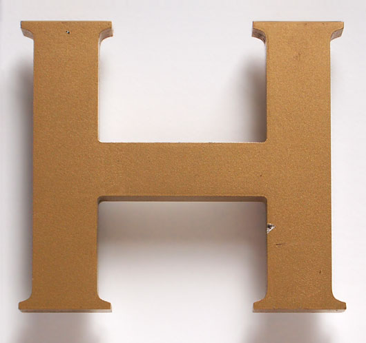 Vintage pub sign painted gold letter 'H'