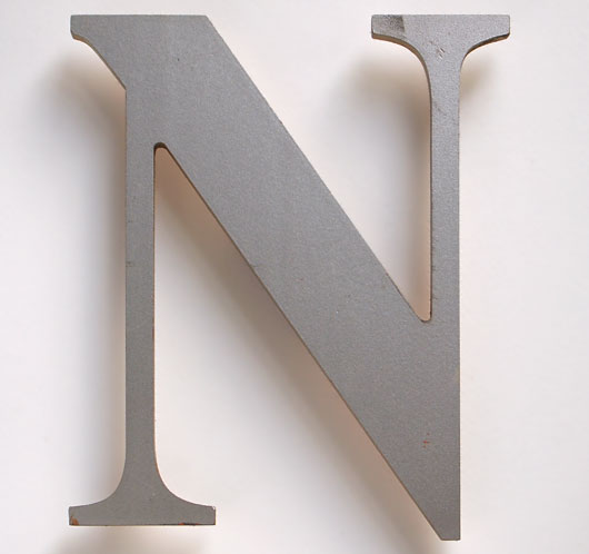 Vintage ex-pub sign painted silver letter 'N'