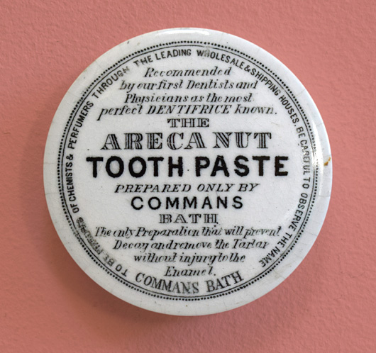 Victorian pot lid wall hanging: Areca Nut Tooth Paste